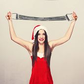 Young Woman With Expander In Santa Hat