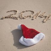 Santa Hat And 2014 Numbers Writing On Beach