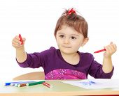 image of montessori school  - Little girl with enthusiasm draws colored markers while sitting at the table - JPG