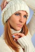 beautiful young woman with white sweater
