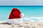 Santa Claus Hat At Caribbean Sandy Beach, Cancun