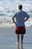 Man Looking Out at Sea