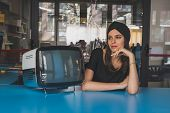 Beautiful Young Brunette Posing Beside A Vintage Tv