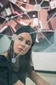 Beautiful Young Brunette Posing Behind A Virtual Screen