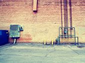 alleyway building and walls toned with a retro vintage instagram filter