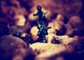image from outdoor texture background series (toy soldiers at war) toned with a retro vintage instagram filter effect