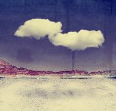 alleyway building and wall with a cloud floating in front toned with a retro vintage instagram filter