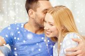love, people and family concept - smiling couple hugging at home
