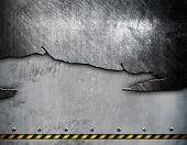 cracked metal with warning stripes