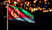 Eritrea National Flag City Light Night Bokeh Background 3D