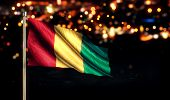 Guinea National Flag City Light Night Bokeh Background 3D