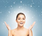 Happy teenage girl over Christmas background