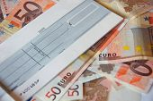 euro bills and cheque book