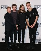 LOS ANGELES - NOV 23:  Ben McKee, Daniel Platzman, Daniel Wayne Sermon, Dan Reynolds, Imagine Dragons at the 2014 American Music Awards at the Nokia Theater on November 23, 2014 in Los Angeles, CA