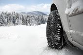 Winter tire in snow �?�¢?? close up