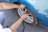Fill Air In A Car's Tire