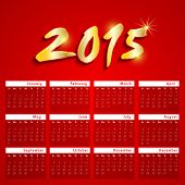 Happy New Year calendar, decorated with shiny golden text 2015.