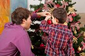 pic of rudolf  - Young father and his son dressing the Christmass tree - JPG