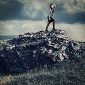 Businesswoman on a mountain