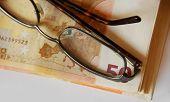 euro bills and glasses
