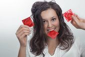 Girl With  With Three Red Condom Packs