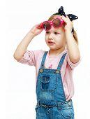 Little girl trying on glasses.