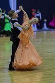 Minsk-belarus, October 4,2014: Unidentified Dance Couple Performs Juvenile-1 Standard European Progr
