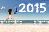 Woman Jumping On Beach Celebrate New Year