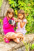 Two little girls with a bird