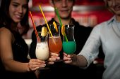 stock photo of gathering  - group of people gathering in cocktail bar and having fun - JPG