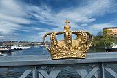 Royal Crown On A Skeppsholmen Bridge In Stockholm