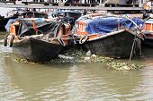 KOLKATA, INDIA - FEBRUARY 14: River boats waiting for the passengers at the dock on February 14, 2014. Third biggest indian city, Kolkata is home to approximately 14.1 mill.people