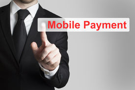 picture of payment methods  - businessman in black suit pushing flat button mobile payment - JPG