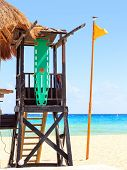 foto of beach hut  - Lifeguard hut and yellow flag on caribbean beach - JPG