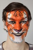 pic of face painting  - Smiling funny man with face painting tiger - JPG