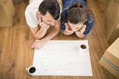 picture of  habits  - The young happy couple planning a new house - JPG