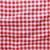 Постер, плакат: Red linen crumpled tablecloth background