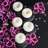 stock photo of geranium  - beautiful spa still life of geranium flower beads and candles in reflection water closeup - JPG