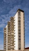 stock photo of high-rise  - A modern high rise building in the swedish town of Hoganas - JPG