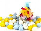 pic of pastel colors  - Artificial easter eggs in pastel colors and a colorful chicken over white - JPG