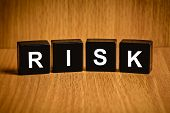 picture of risk  - risk text on black block - JPG