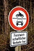 stock photo of sidecar  - road sign ban of cars and motorcycles in the wood in germany. Ban on motorcycles with sidecars; mopeds and scooters; as well as for cars and other track vehicles.