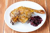 stock photo of roast duck  - Roasted duck with cherry sauce on white plate - JPG