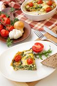 image of baby goat  - Closeup of plate with one piece of fresh made frittata bread and tomatoes - JPG
