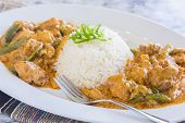image of curry chicken  - Chicken thighs and green bell peppers in panang curry sauce served with rice - JPG