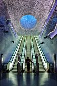 picture of escalator  - boy waiting blue and sky escalators in napoles - JPG