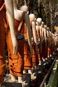 stock photo of stairway  - Statues of Buddhist nuns line the stairway at Sambuk Mountain Monastery Kratie Cambodia - JPG