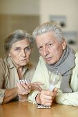 picture of influenza  - Elderly caucasian couple ill with influenza at home - JPG