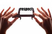 foto of respect  - Color horizontal shot of two hands holding a caliper and measuring the word  - JPG