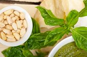 image of pesto sauce  - Italian traditional basil pesto sauce ingredients on a rustic table - JPG
